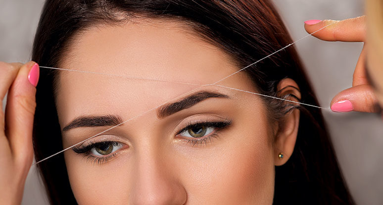 Photo of Plucking eyebrows with thread and thread technique